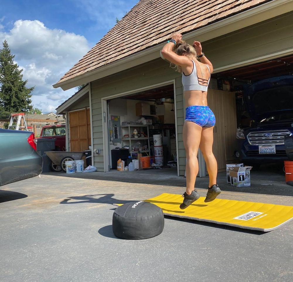 Emily doing burpees in an at-home workout in the driveway