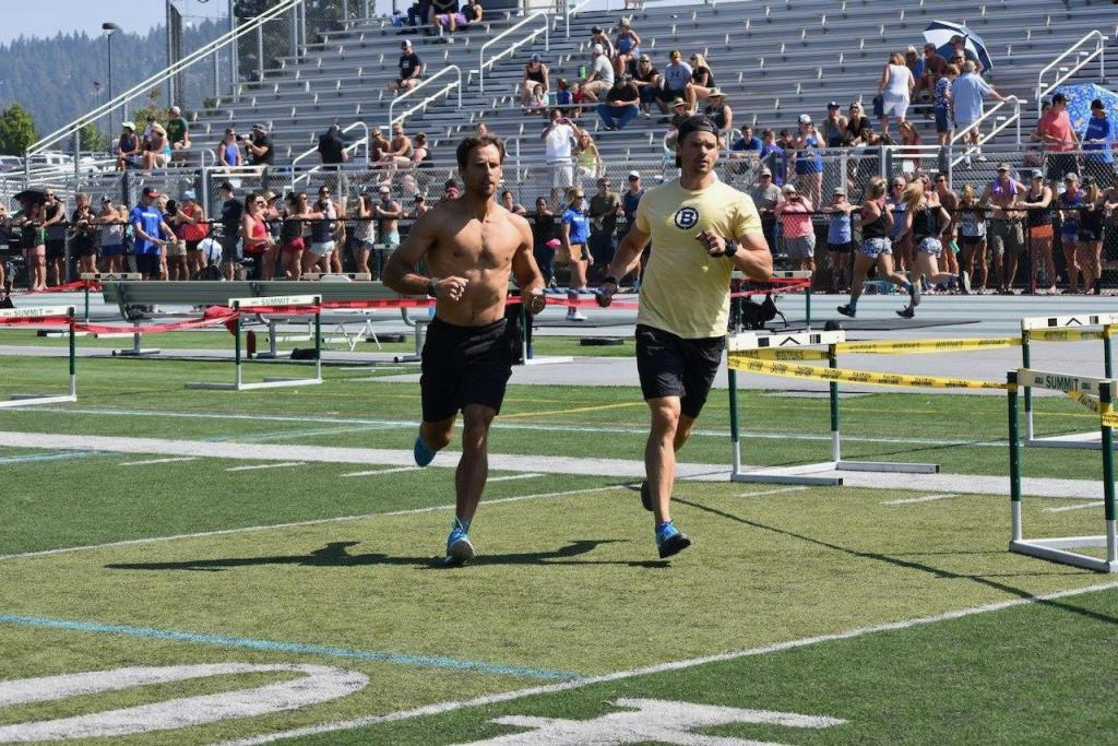 Andy and Joe running in CrossFit competition