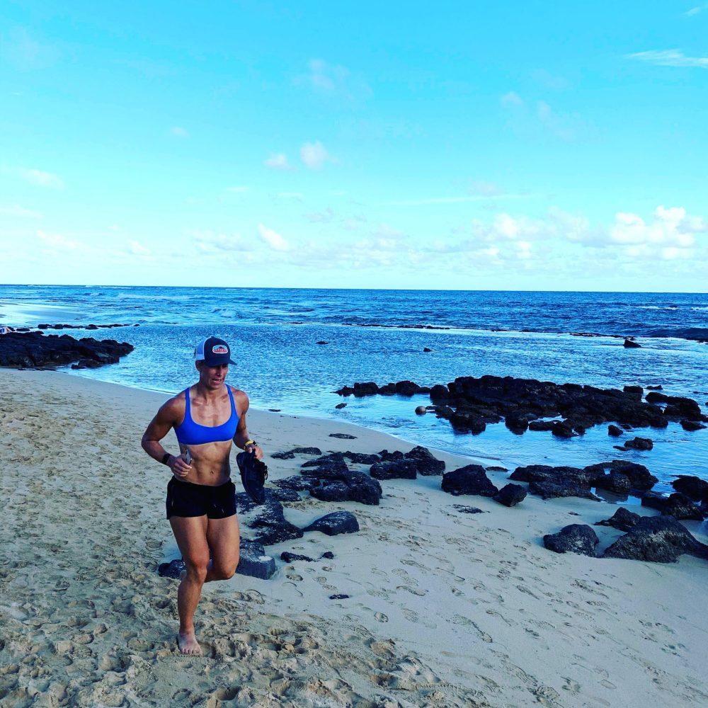 Emily running on the beach in Kauai