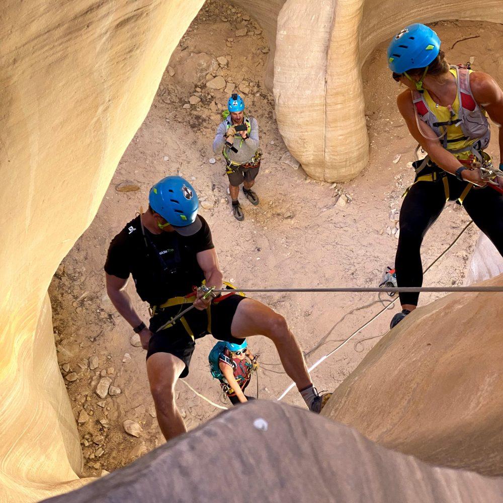 Emily and Joe rapelling while rock climbing