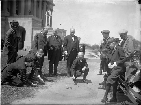 Marbles was so popular, here a US Senator (Ownes) is playing with some boys.
