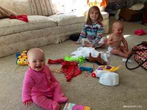 Just at the beginning of making big messes! I was around the corner and didn't realize the wipes were so accessible to Adelynn (back), when I came close and found wipes everywhere i asked, 'what are you doing?' this is the grin I got from everyone!