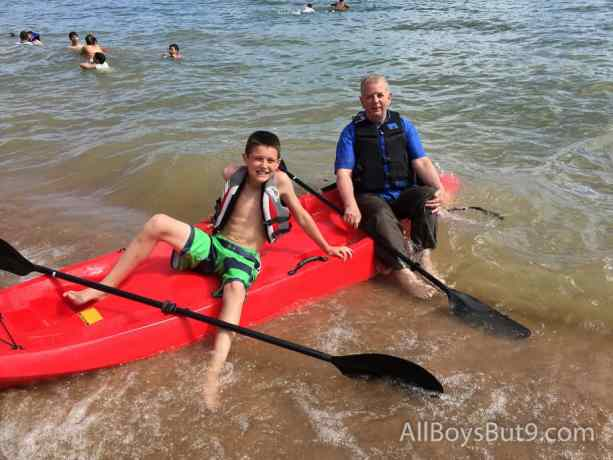 grandpa and grandson head out in the kayak - with grandpa fully- clothed!