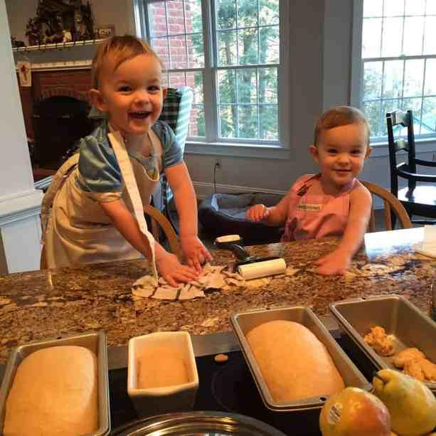 Addie and Sarah helping mom make bread!