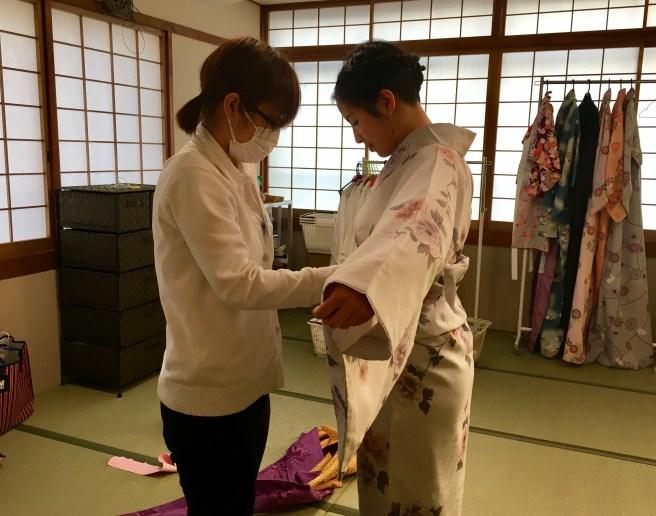 Folding the Kimono at the waist to fit the Obi