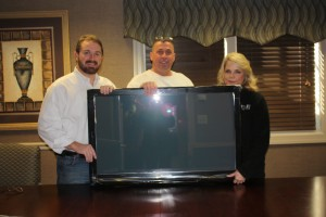 Jack Wingate & Mike Reese Of ALLCHOICE Give TV To Dixie Hull
