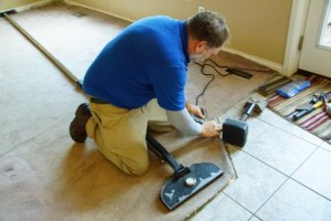 Power Stretching carpet and attaching to Tile