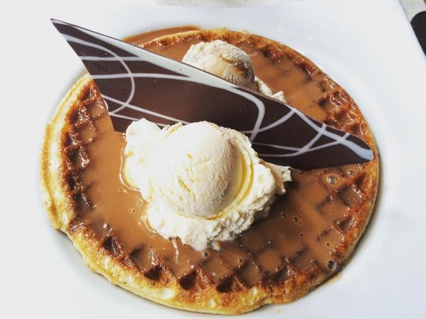 arequipe and ice cream on top of a waffle
