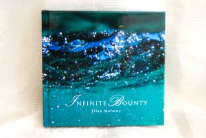Infinite Bounty book on white cloth straight
