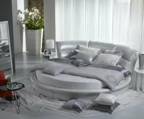 Rundbetten ermitteln eine gehobene Atmosphre im Schlafzimmer