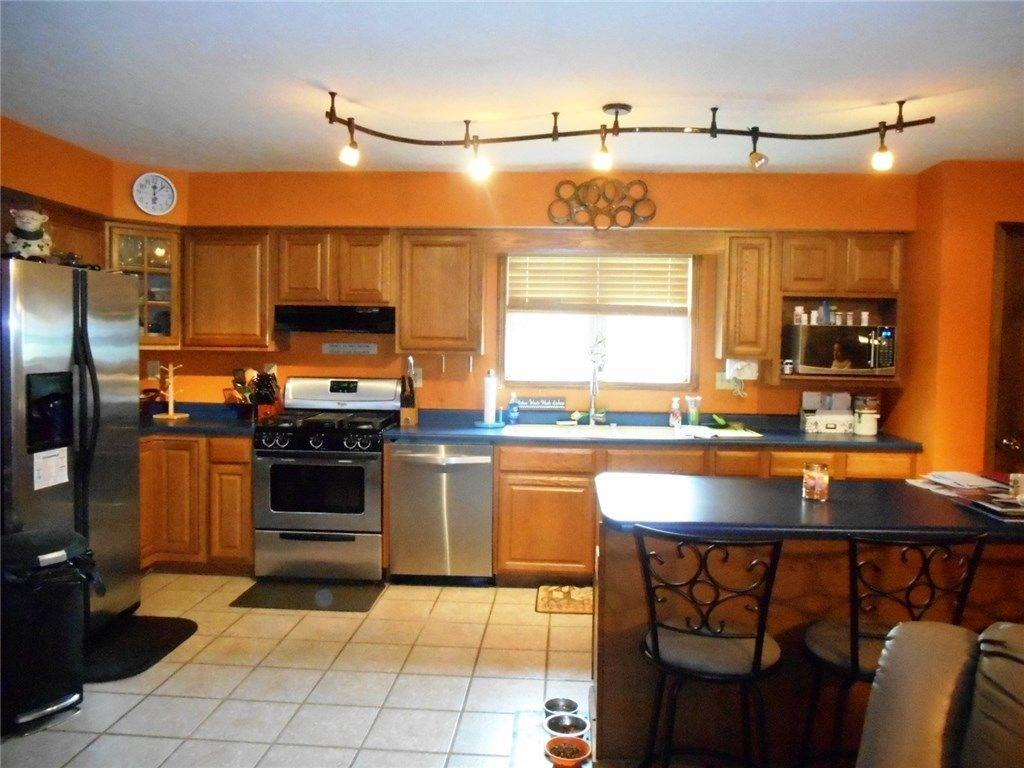 Ranch style home offering open concept floor plan wnice kitchen and loads of cabinetry  Allen