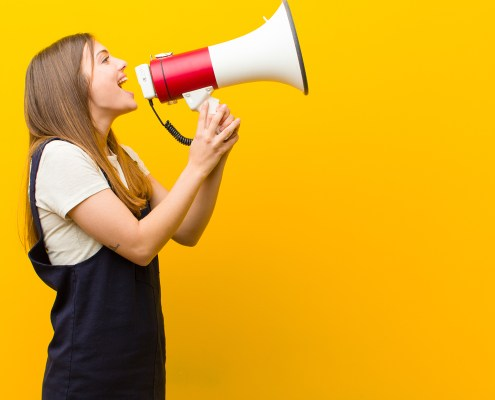 Crisis communication header image of girl speaking through megaphone