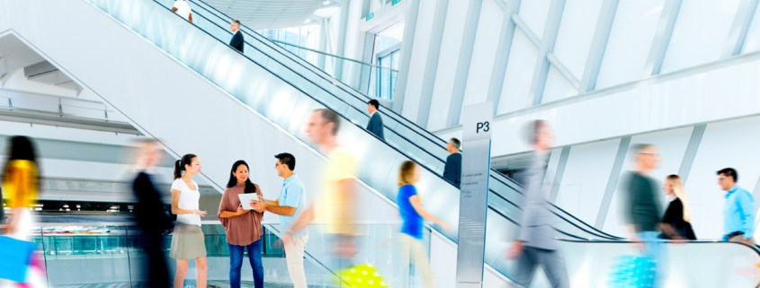 Image of people walking in a building for article B2B Buyer Personas