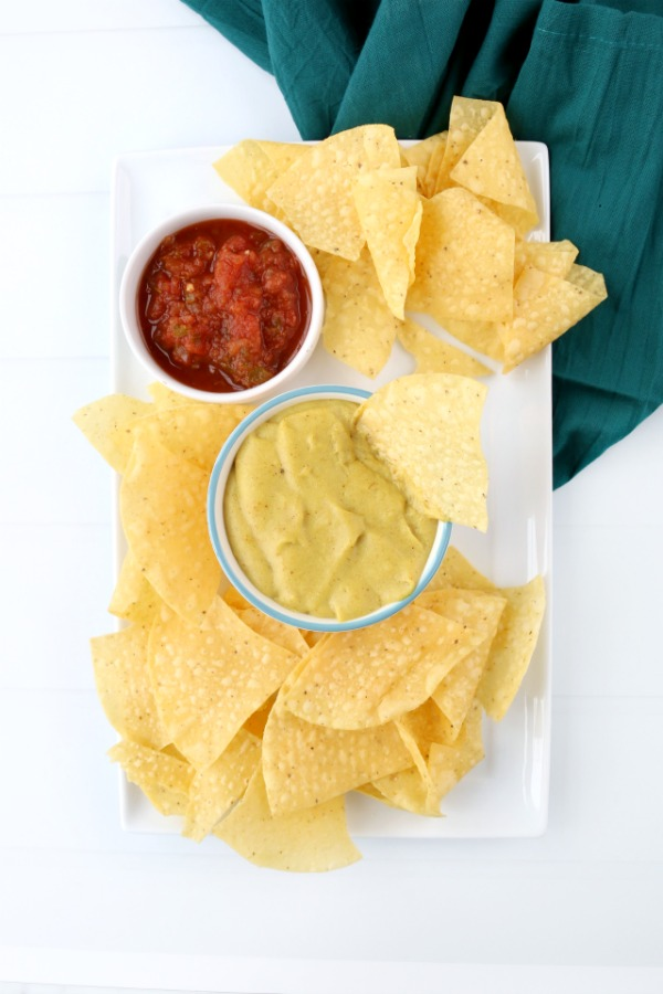 Vegan cheese sauce with nachos and salsa