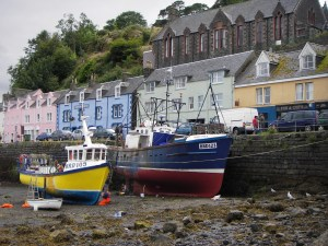 Two fishing boats at low tide in Portree, Skye