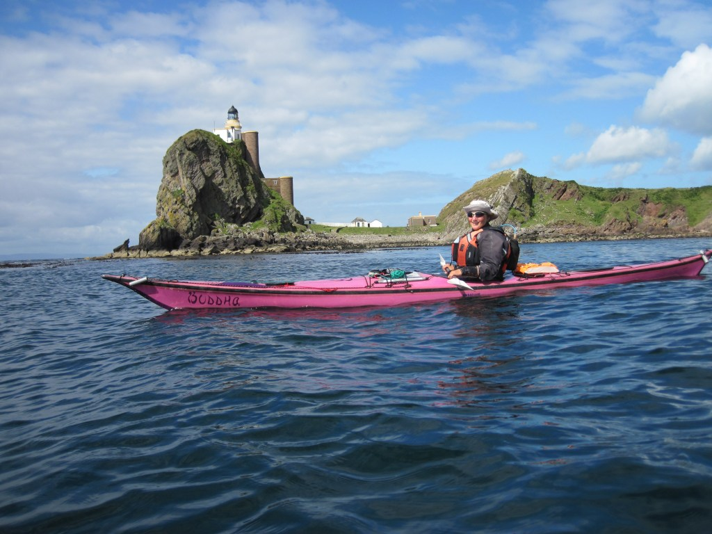 Me and my kayak named Buddha in front of Sanday island lighthouse