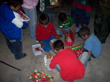 Boys checking out their gifts