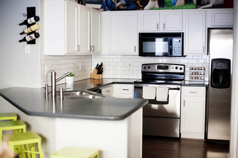 Kitchen re-do at allforthememories.com white cabinets with dark gray countertops