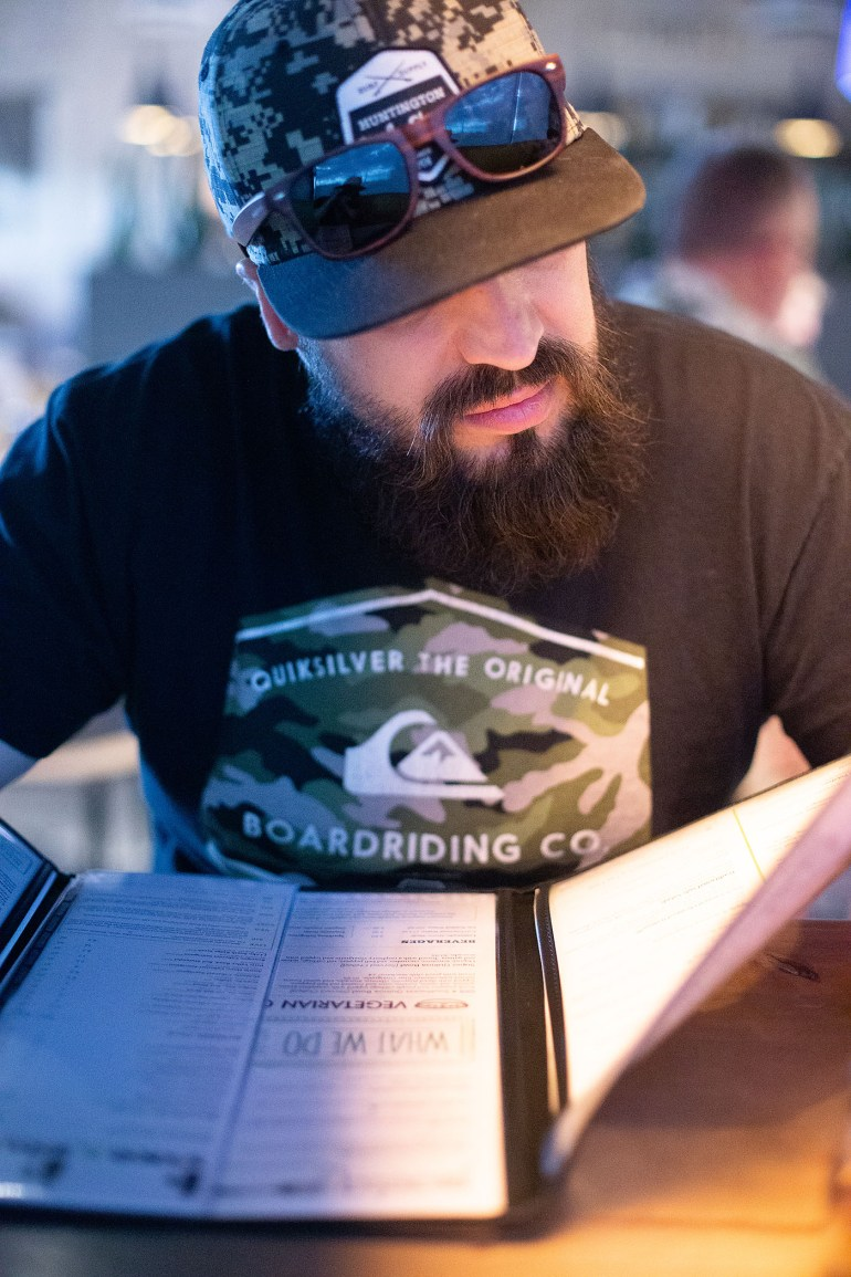 Man looking at menu