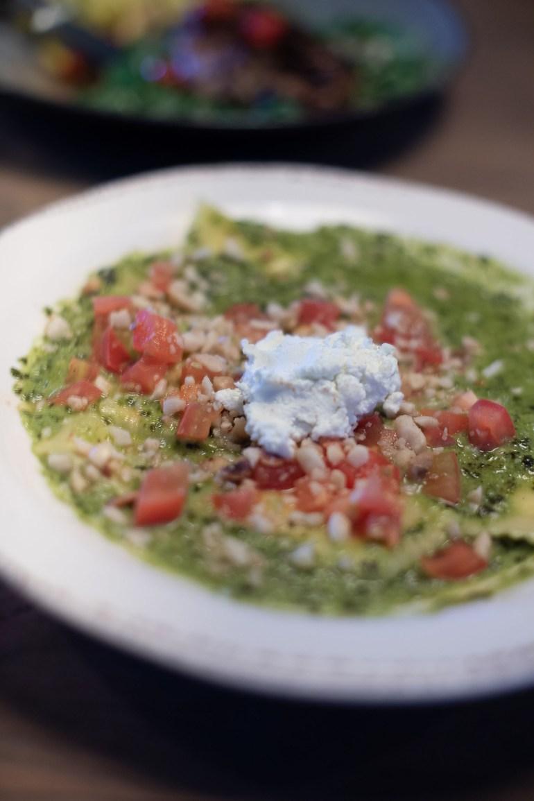 Gluten free ravioli with green pesto sauce