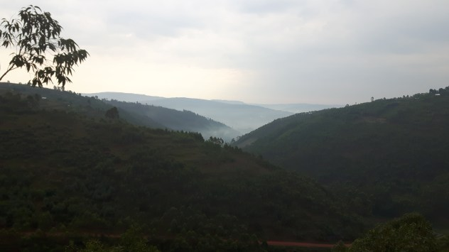The climb up to Lake Bunyonyi. The town of Kabale is under the fog in the valley.