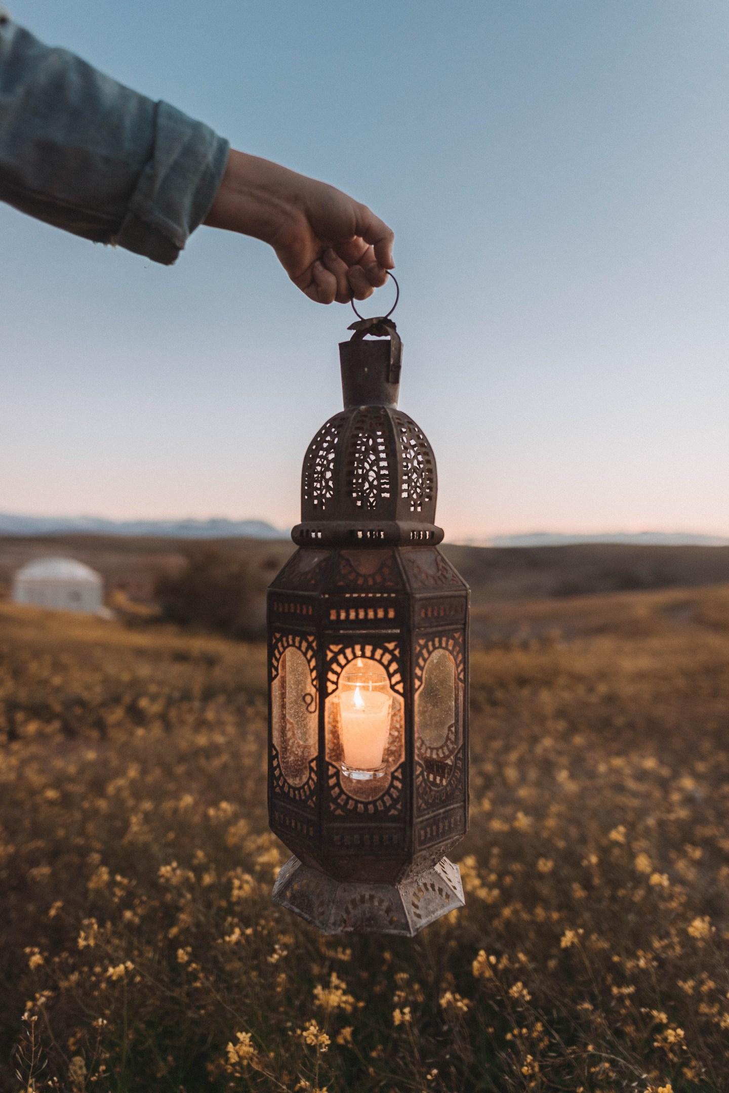 Moroccan lantern in Agafay desert at dusk