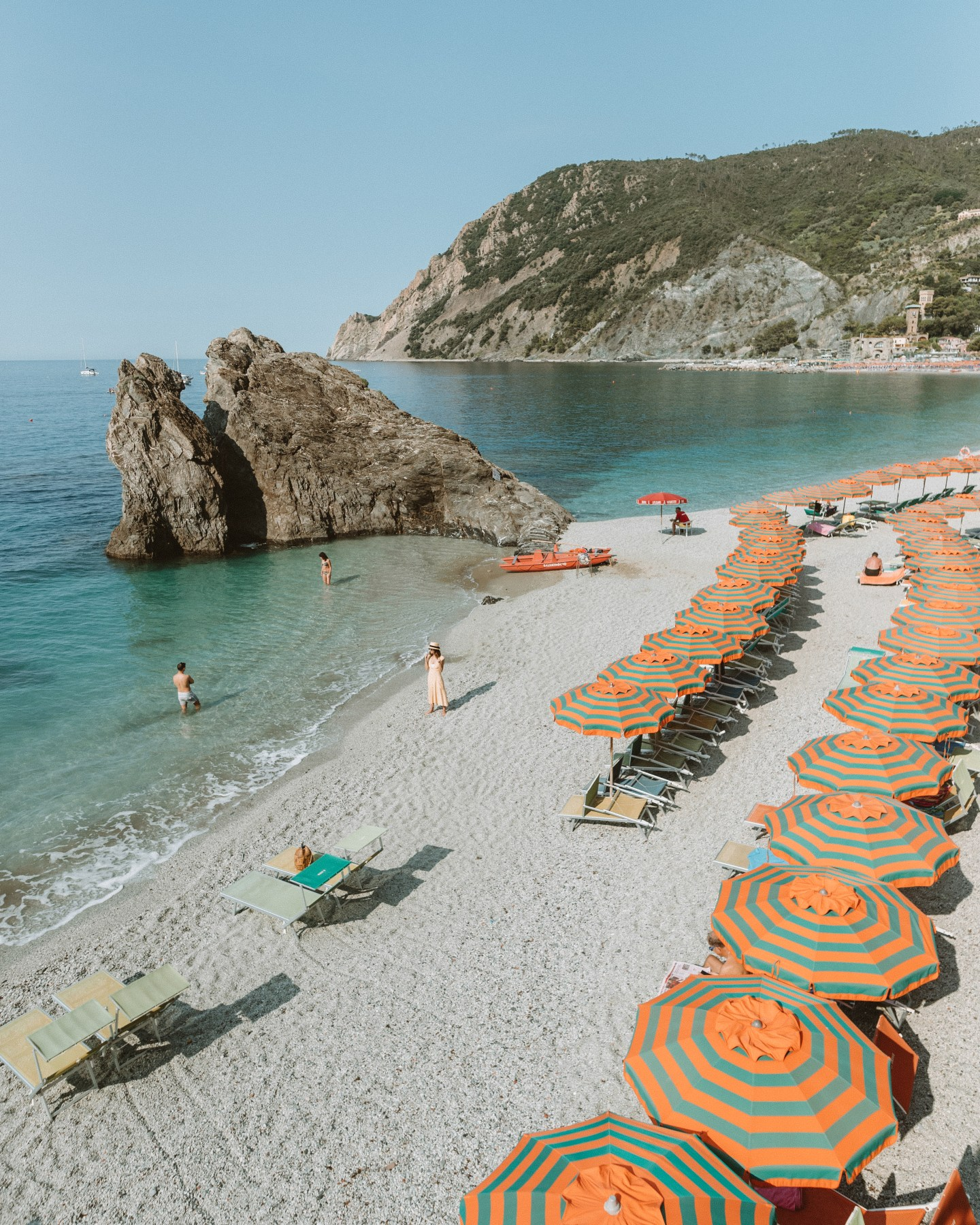 umbrellas on a beach in monterosso cinque terre italy