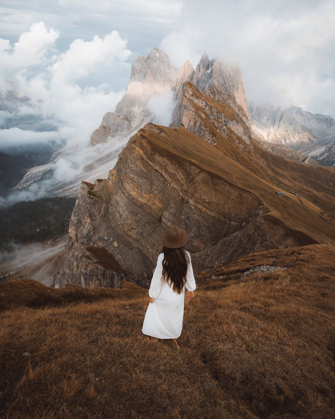 Girls standing looking towards Seceda, Dolomites, Italy