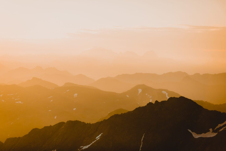 Orange surise over mountain layers