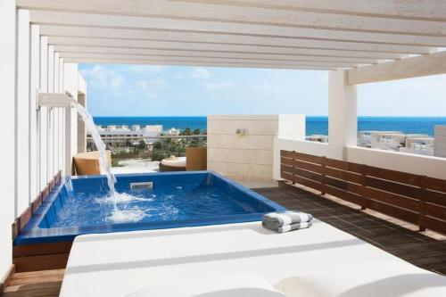 Beloved Playa Mujeres balcony plunge pool