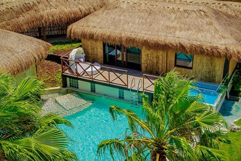 Secrets Silversand Riviera Cancun over-the-pool cabana honeymoon suite
