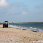 Dreams Playa Mujeres tractor cleaning up the sea grass