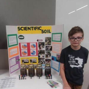 Tyler with Science Fair poster pic
