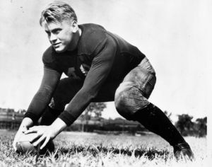 Gerald Ford with a football