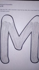 The M is colored in gray with the tips left white to look like snow.