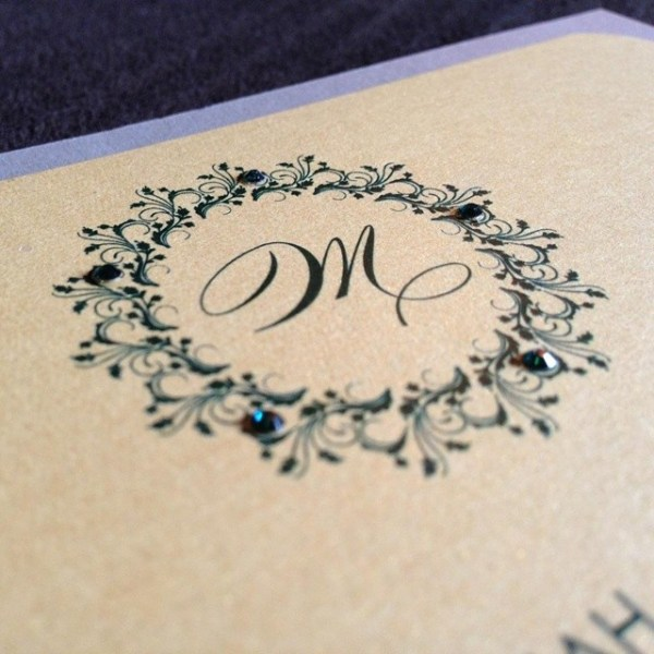 A lovely monogram surrounded by beautiful emerald rhinestones