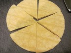 Corn tortillas cut into wedges for frying.