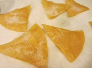 Fried tortilla wedges sprinkled with sugar.