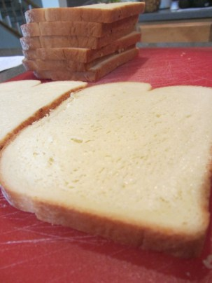 8 slices of potato bread with 2 buttered.