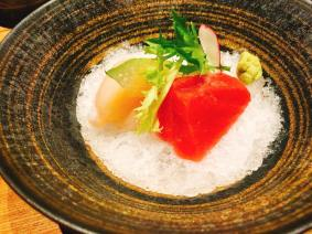 Chef's two kinds of sashimi nestled in shaved ice with fresh Wasabi & Yuzu onion sauce