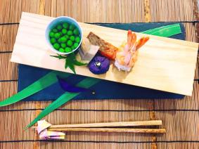 Assortment of Appetizer (Hassun): Green peas, Samurai helmet shaped shrimp sushi, Arrow feather shaped lotus root, Grilled Alaskan sockeye salmon, Iris shaped purple yam