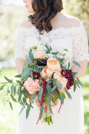 A Modern Sisterdale Dancehall Wedding in Boerne Texas by Allison Jeffers Wedding Photography featuring a sage, burgundy, and pale pink color palette 0034