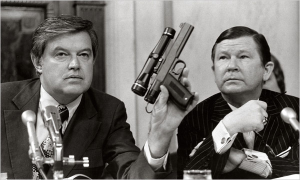 POISON DARTS Senator Frank Church, whose committee looked into intelligence abuses, shows a dart gun from a C.I.A. lab in 1975. (Henry Griffin/AP)