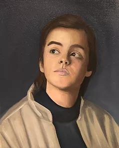 teenage boy wearing brown jacket on black background