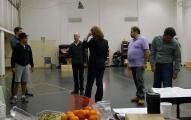 Tosca BTS - John Caird giving direction to cast during stagin rehearsal