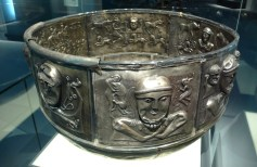 The Gundestrup Cauldron, the largest known example of Iron Age silverware, was deposited in a Danish bog about a century before the time of Christ. It bears images of gods and sacrifice.