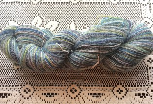 This yarn is a Merino/mohair blend and is a 2-ply that was spun from a center-pull ball.