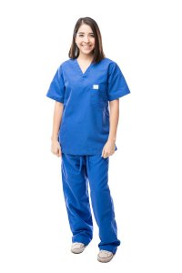 A Phlebotomist wearing blue scrubs in Allied Health