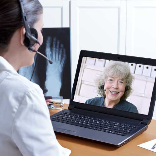 telehealth clinician talking to patient over video conference