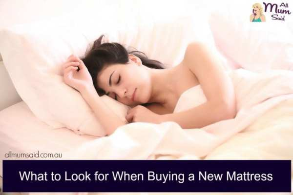 woman sleeping on bed after buying a new mattress